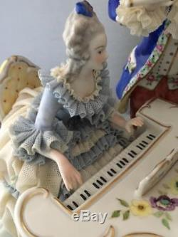 Vtg Irish Dresden Lace Porcelain Group Piano Lady & Magic Flute Man Figurine